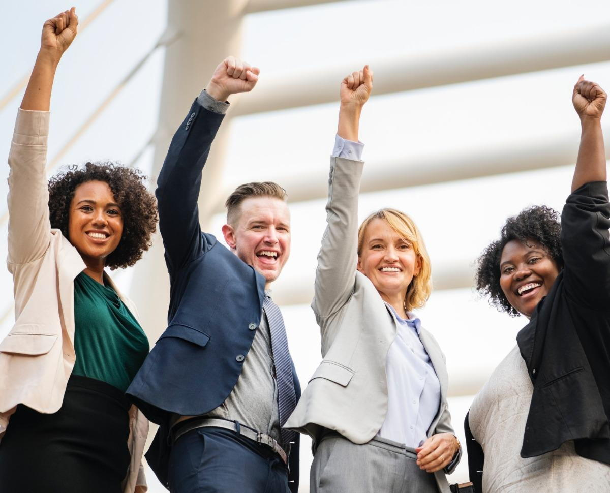Photo of Entrepreneurs throwing their fist in the air during a business coaching session