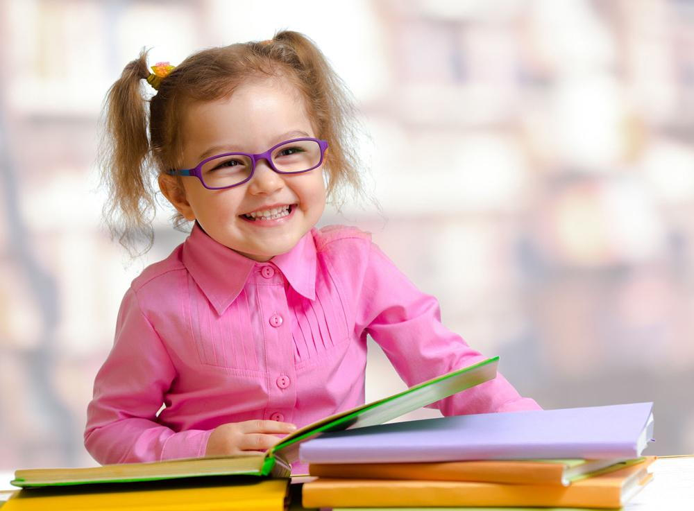 Toddler in glasses.