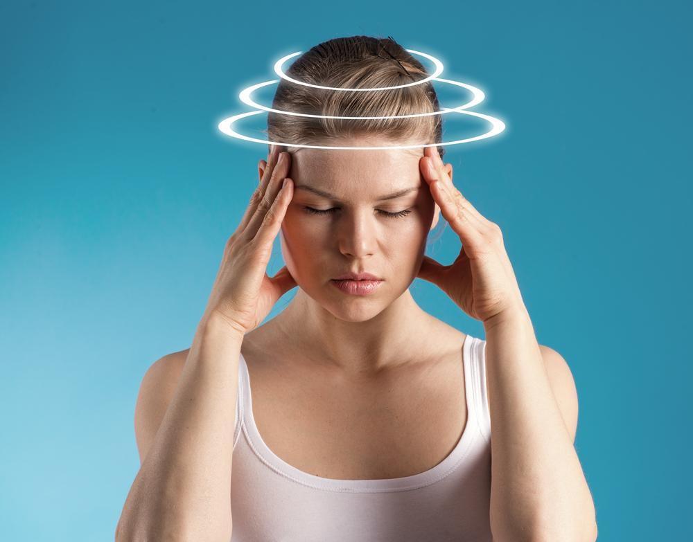 Woman suffering from headache in Omaha