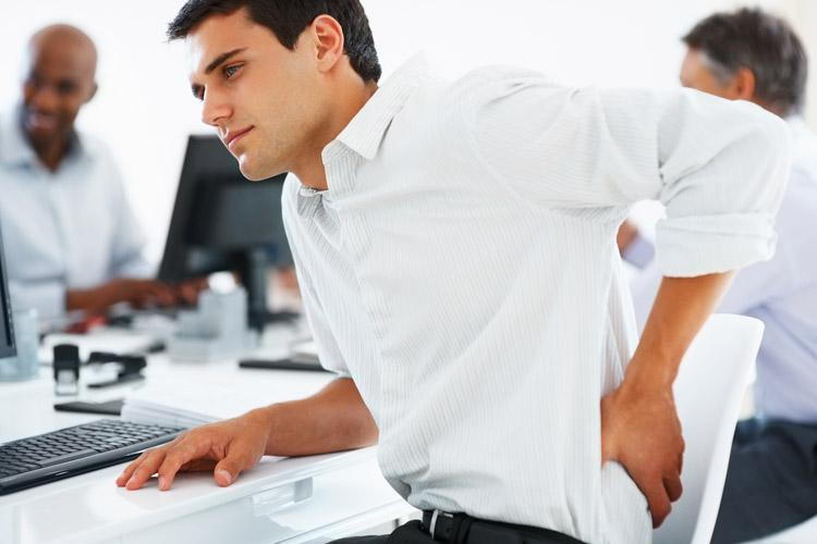 Man Working Experiencing Back Pain
