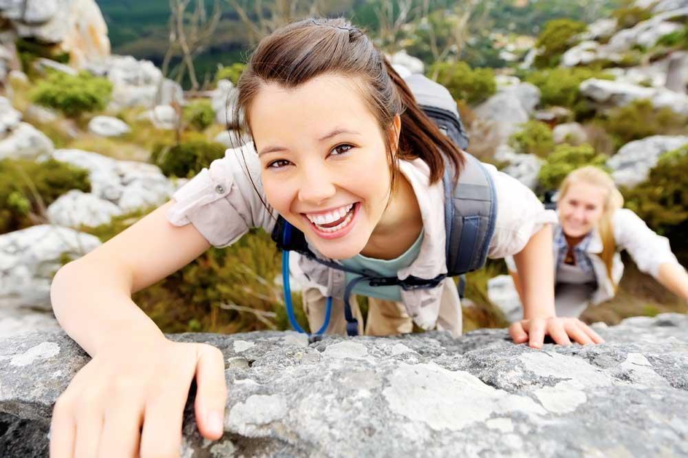 Healthy girl rock climbing