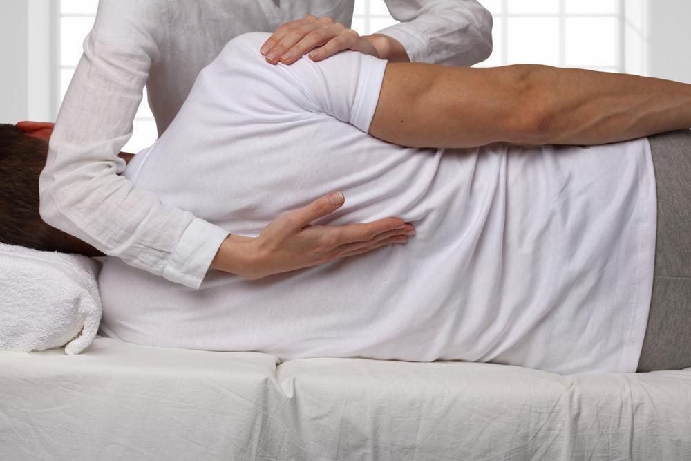 Kenosha Chiropractor Adjusts Patient with Back Pain
