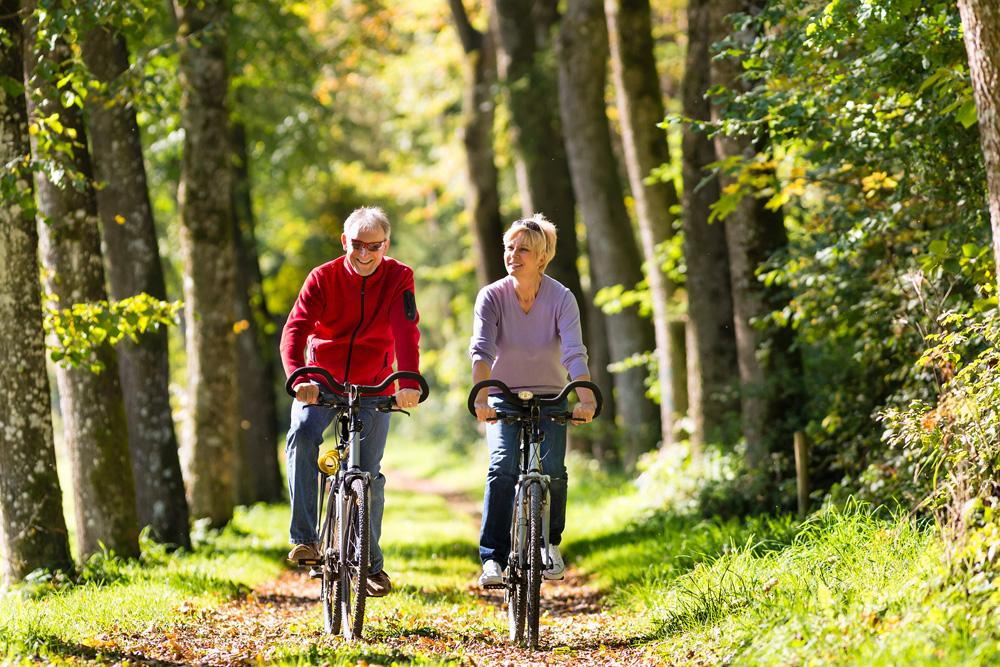 couple biking in the woods