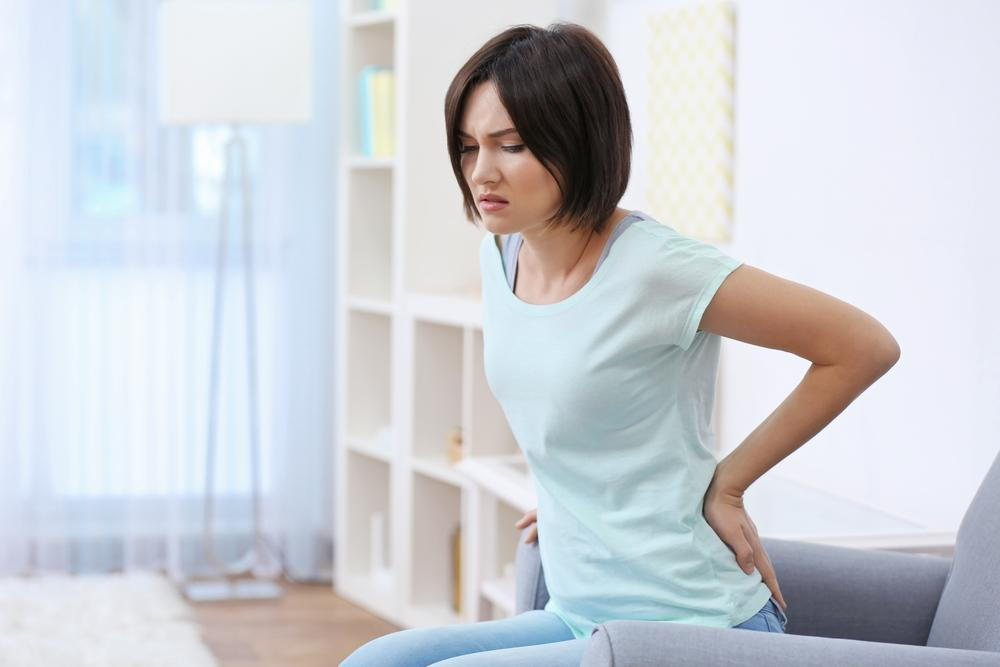 Woman suffering from low back pain
