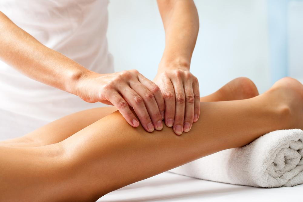 Omaha chiropractor giving a sports massage to the leg of the client