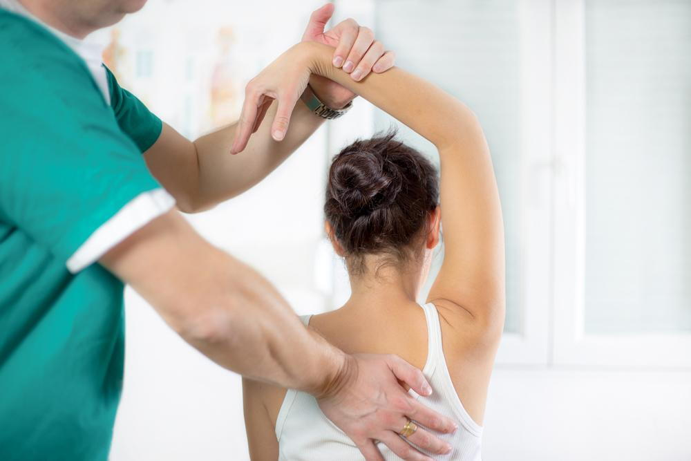 chiropractor getting ready to preform spinal decompression on a patient