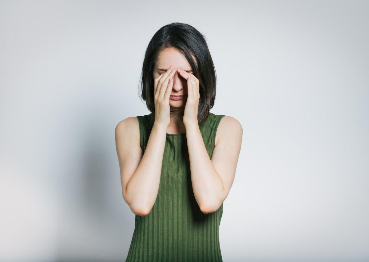 Woman rubbing her dry eyes