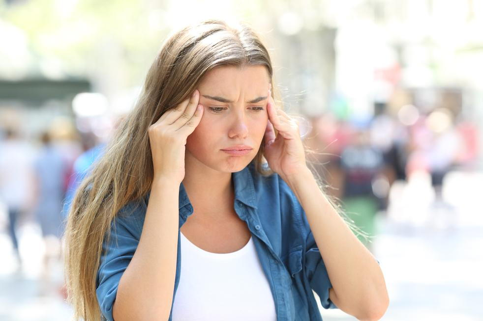 girl going to chiropractor for headache pain