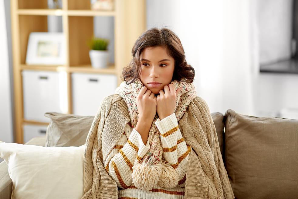 woman experiencing detox symptoms after chiropractic adjustment