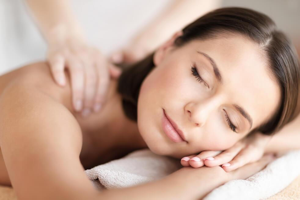 woman getting massage after chiropractor