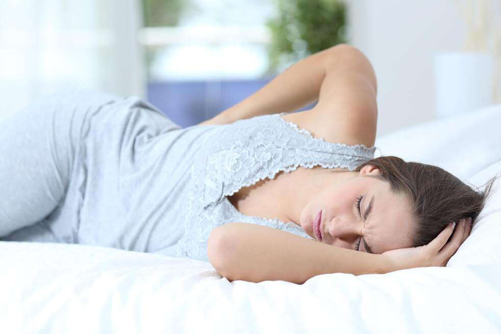 woman in pain wondering how to avoid back pain