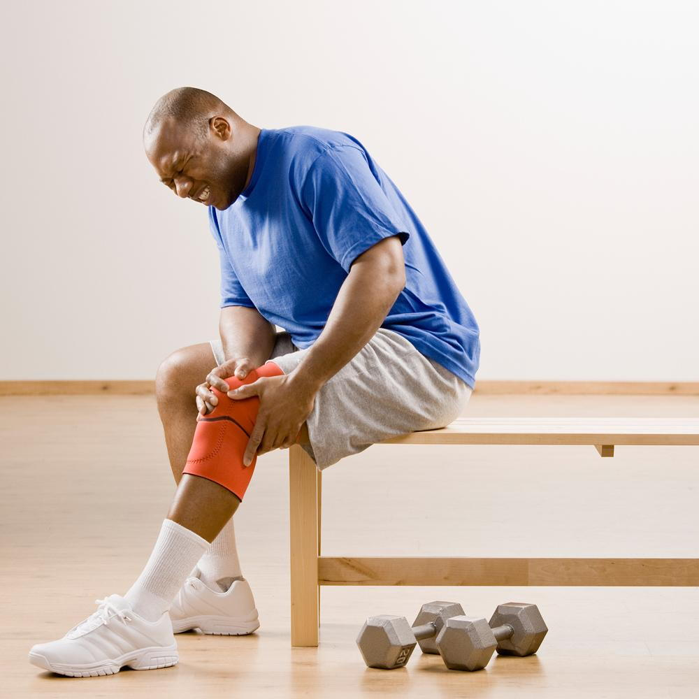 man suffering from knee pain