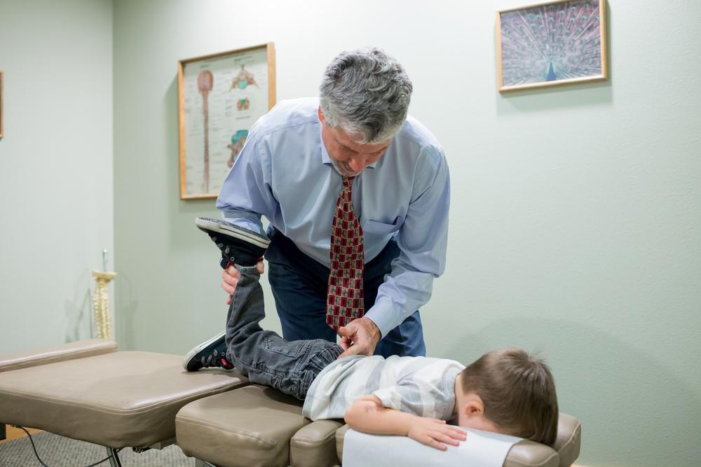 Kid getting Chiropractic Care