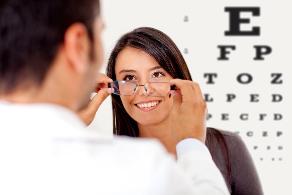 eye doctor giving lady her eye glasses - What To Look For In An Eye Doctor Near Me In Pensacola - Fifty Dollar Eye Guy 5328 N Davis Hwy Pensacola, FL 32503 (850) 434-6387