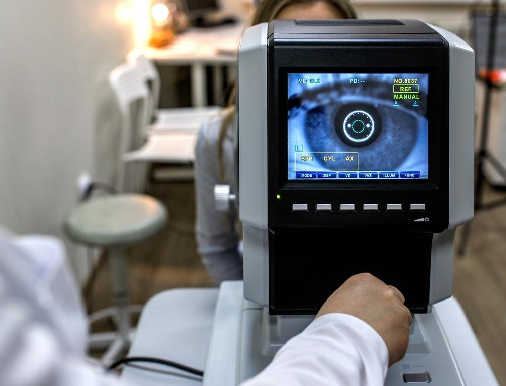 lady looking into an eye machine to get her eyes checked- Is lassik eye surgery in pensacola worth it- Fifty Dollar Eye Guy 5328 N Davis Hwy Pensacola, FL 32503 (850) 434-6387