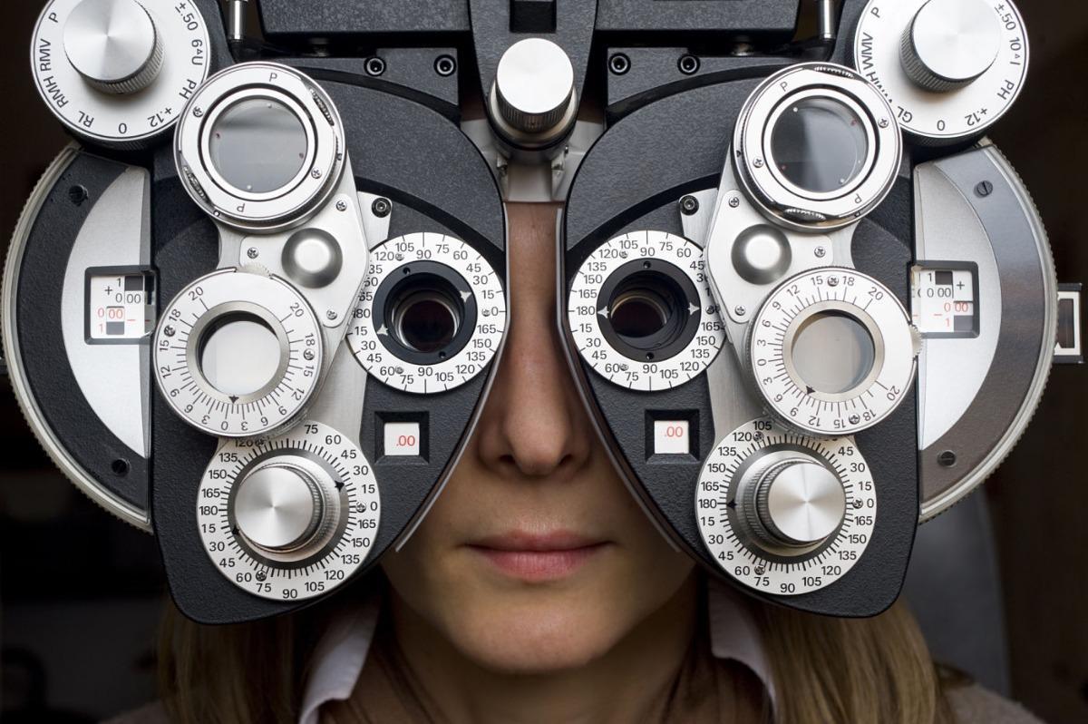 Lady Getting Her Eyes Examined-  What Places Take EyeMed Insurance In Pensacola FL- Fifty Dollar Eye Guy 5328 N Davis Hwy Pensacola, FL 32503 (850) 434-6387