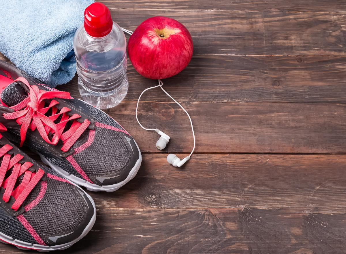 Running shoes, water bottle and ear phones
