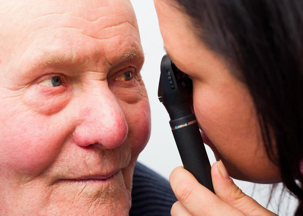 man with diabetic retinopathy getting examined by optometrist