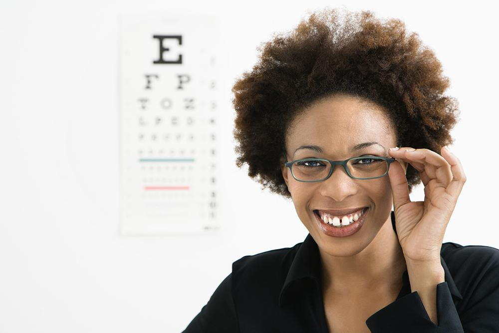 woman smiling with glasses on