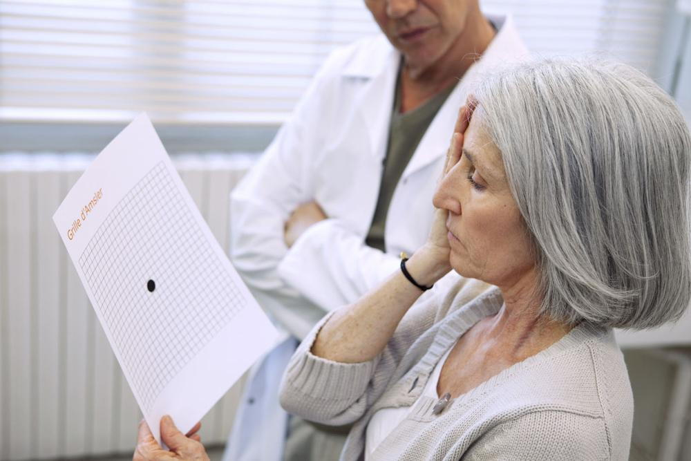 Optometrist checking for macular degeneration