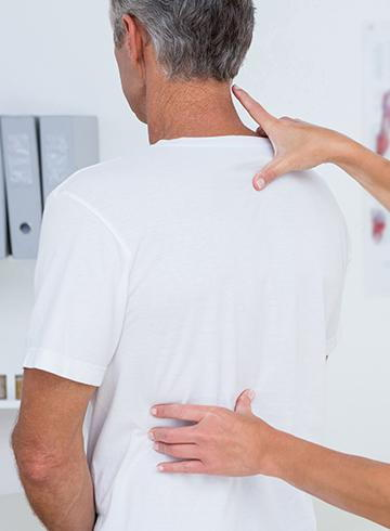patient needing physical therapy for neck pain treatment in New Albany, Indiana