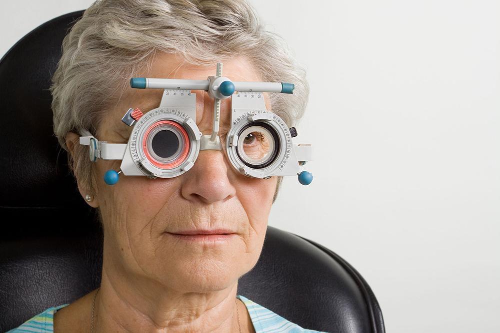 elderly woman getting eye exam for myopia