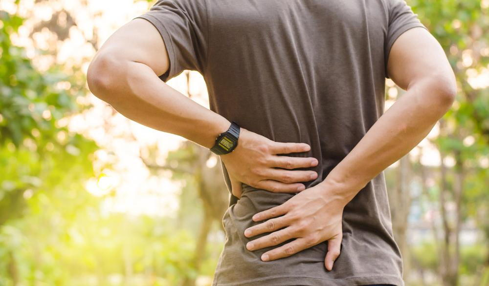 man suffering from a herniated disc