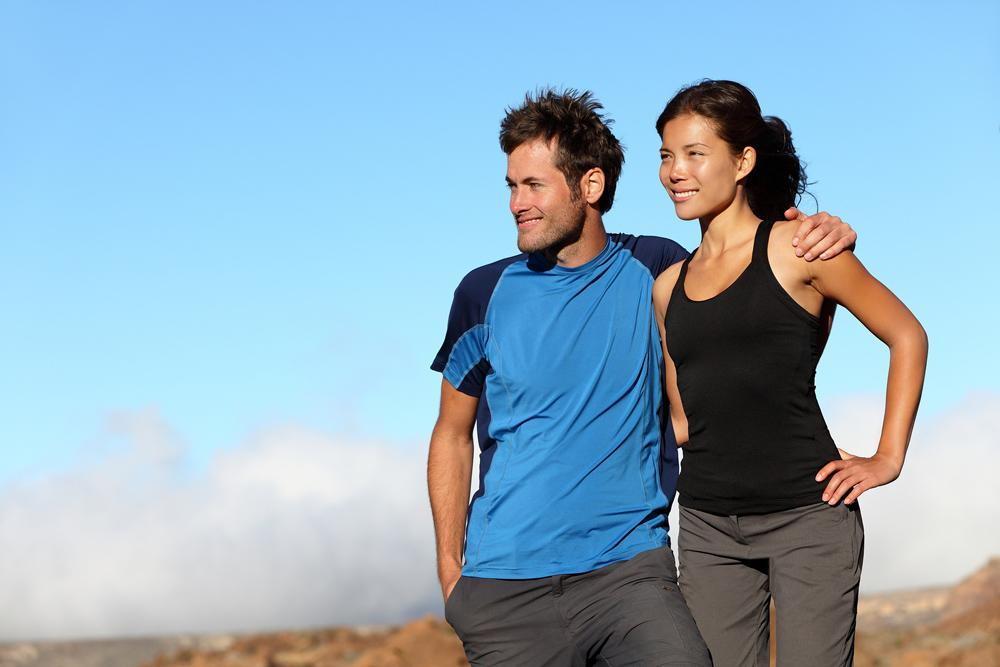 happy healthy couple on a hike