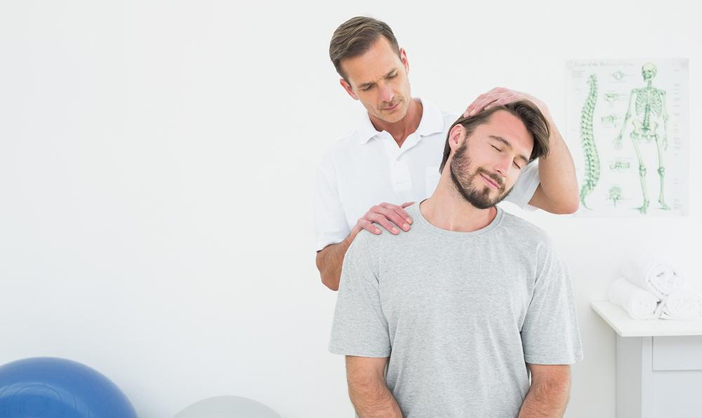 Chiropractor and patient during chiropractic treatment for neck pain