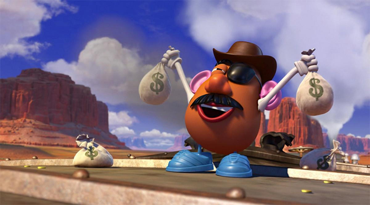 Mr. Potato Head Dressed as Outlaw Holding Money Bags