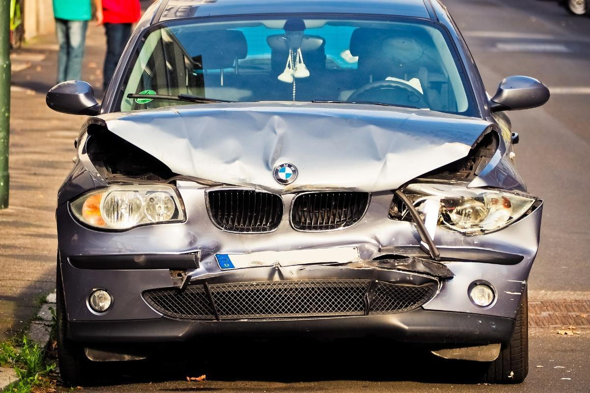 A BMW sedan with front-end damage
