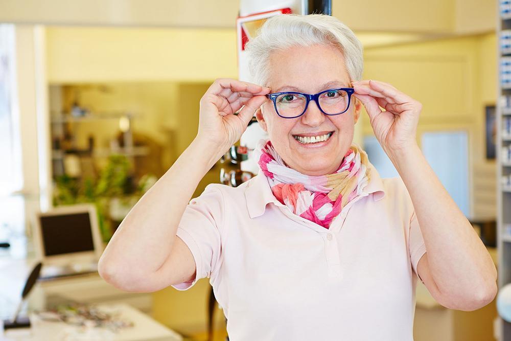 senior citizen getting new eyeglasses