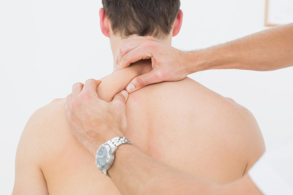 man getting chiropractic treatment