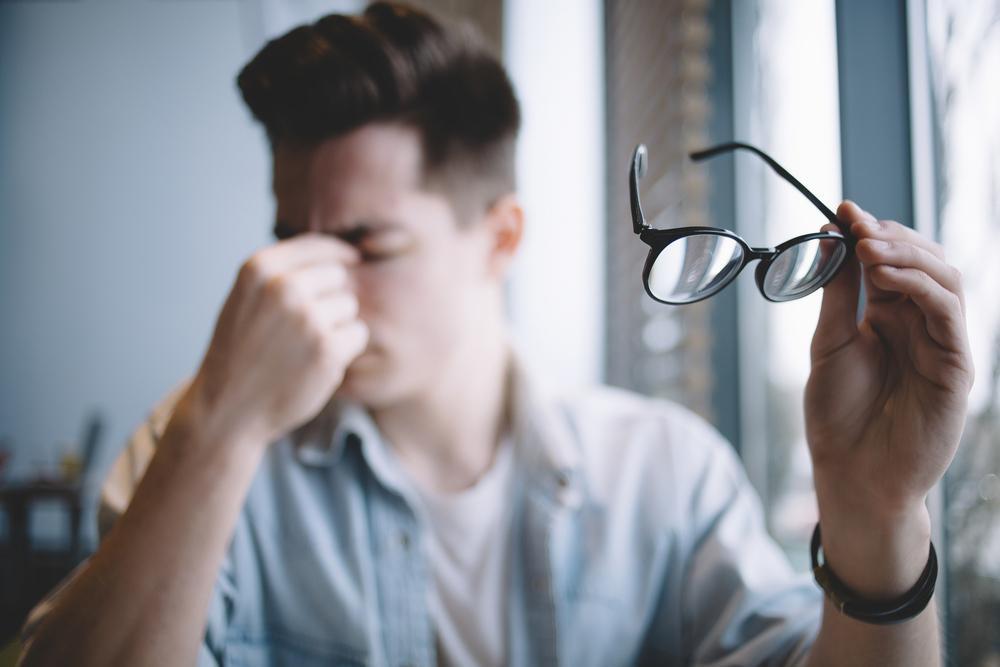 man suffering from eye trauma