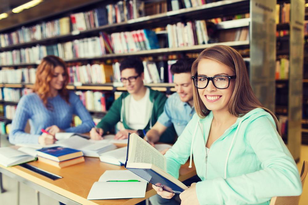Woman wearing glasses in a school library
