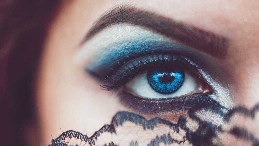 Woman with spooky contact lenses.