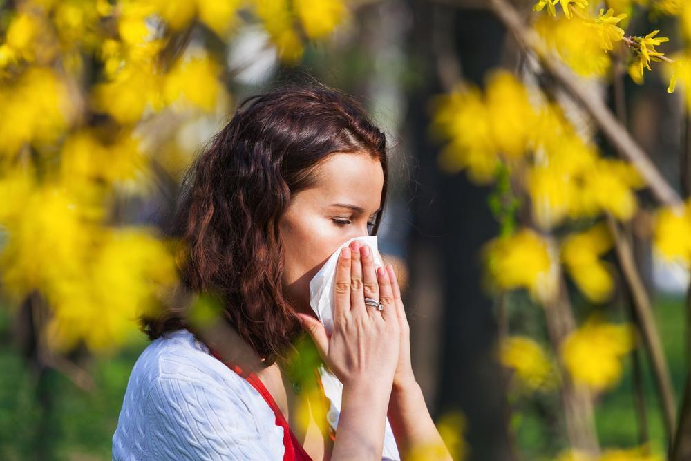 Woman with eye allergies needs to seek an optometrist in Boston.