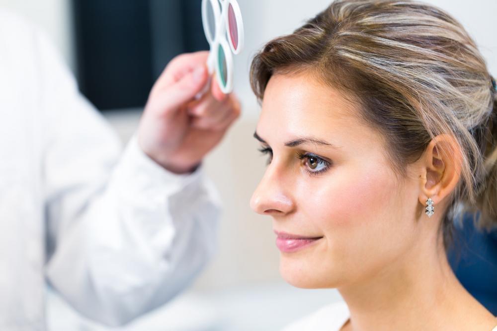 Woman receiving an eye exam in Boston.