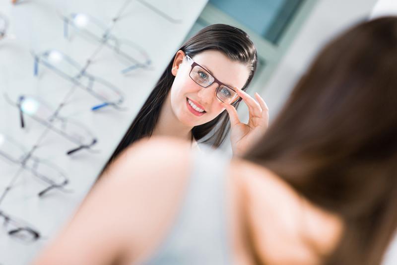 Woman selecting the perfect prescription glasses