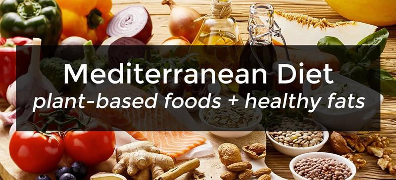 mediterranean diet digestive health benefits with food items in the background