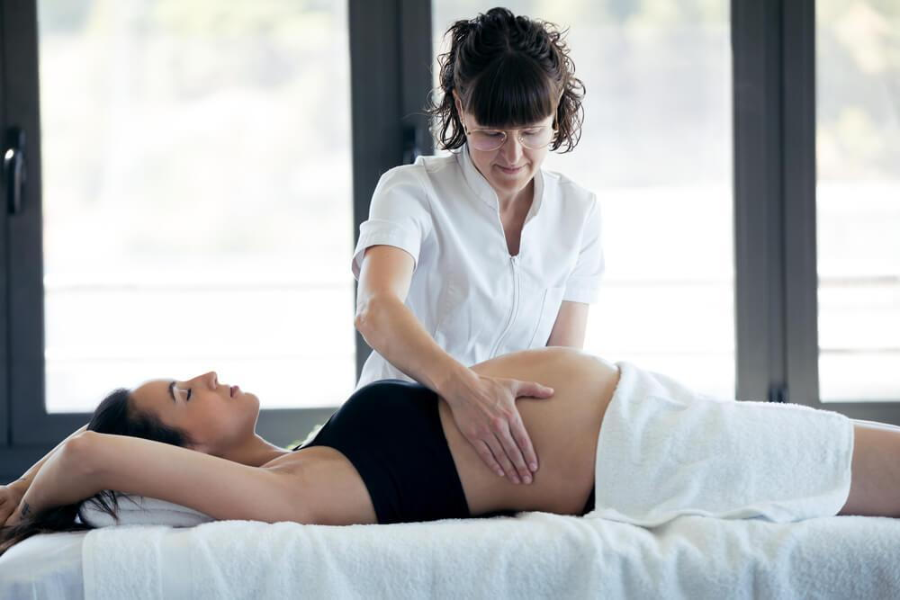 pregnant woman during chiropractic treatment