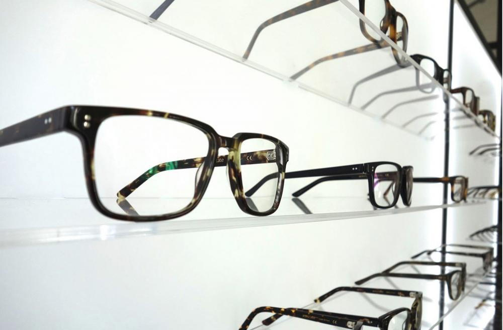 several eye glasses on the wall