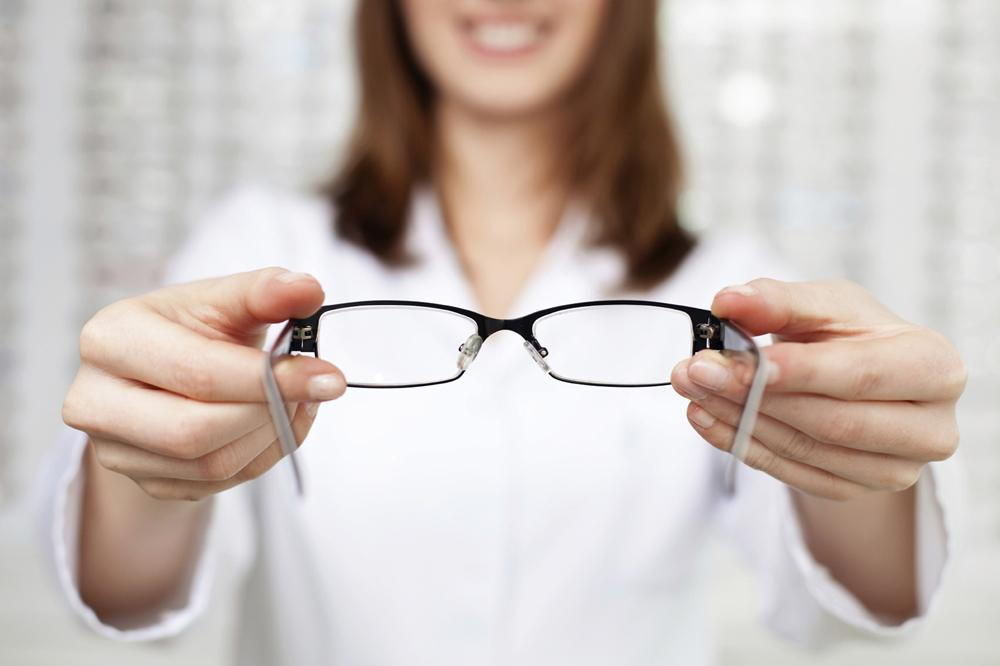 optometrist giving glasses to try on