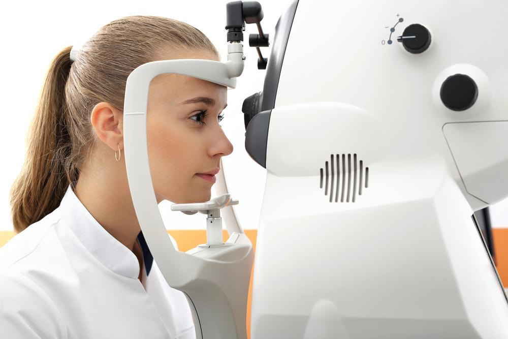Woman getting tested for her vision loss.
