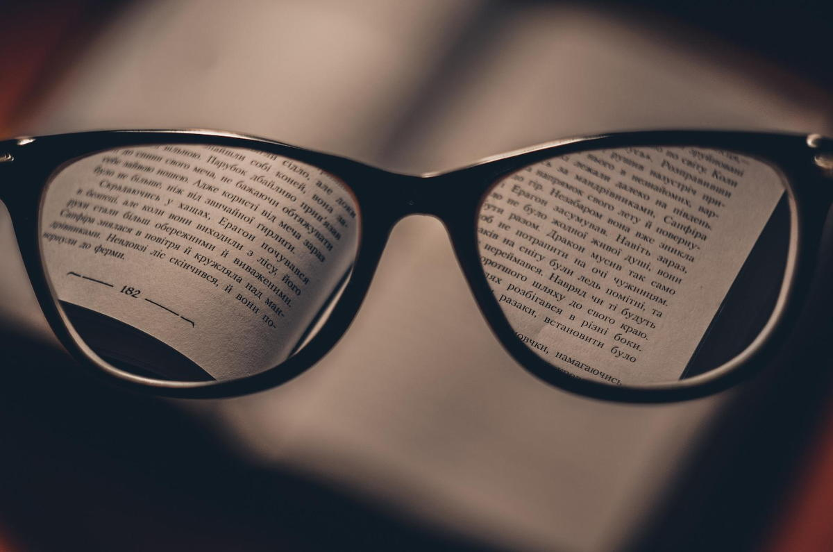 prescription eyeglasses on a book - VSP Insurance Doctors at Fifty Dollar EyeGuy - Fifty Dollar Eye Guy 5328 N Davis Hwy Pensacola, FL 32503 (850) 434-6387 .jpg