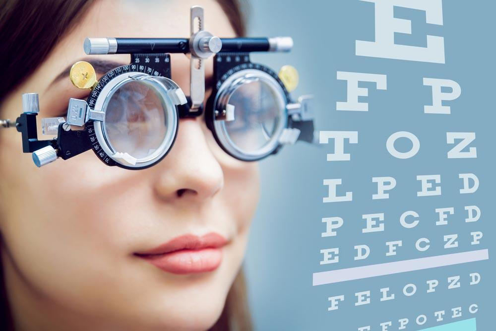 lady getting her eyes checked with an eye chart- when should you get reading glasses in Pensacola- Fifty Dollar Eye Guy 5328 N Davis Hwy Pensacola, FL 32503 (850) 434-6387.jpg