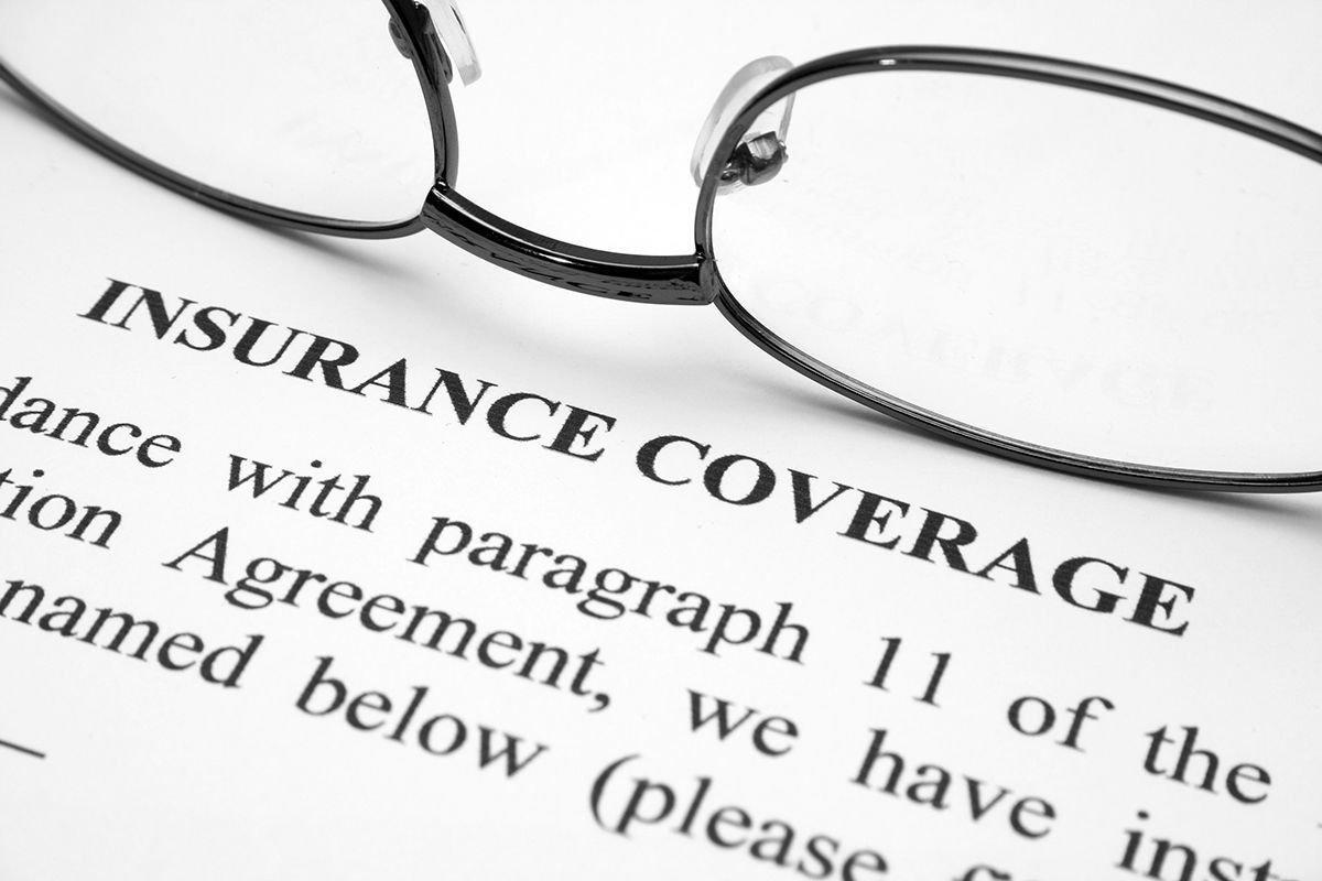 Eye Glasses On Top Of A Piece Of Paper About Insurance Coverage-  What Does EyeMed Insurance Cover Pensacola- Fifty Dollar Eye Guy 5328 N Davis Hwy Pensacola, FL 32503 (850) 434-6387