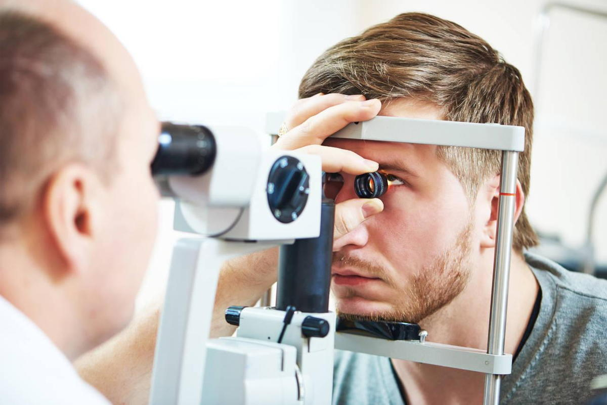 Optometrist Looking Into A Mans Eye- What Are The Benefits Of EyeMed Insurance Pensacola- Fifty Dollar Eye Guy 5328 N Davis Hwy Pensacola, FL 32503 (850) 434-6387