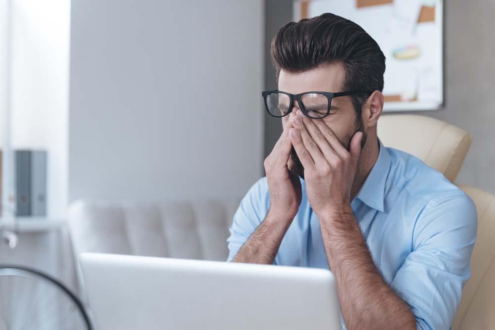 man suffering from dry eye