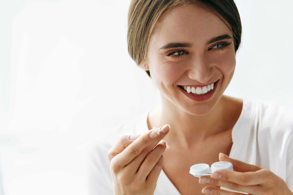 Woman excited with her new pair of contact lenses.
